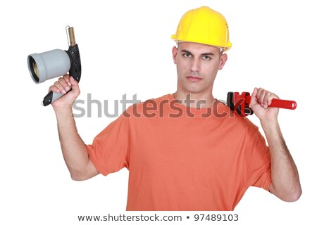 Tradesman holding a pipe wrench and a blowtorch Stock photo © photography33
