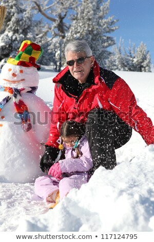 father and grandfather building snowman stock photo © photography33