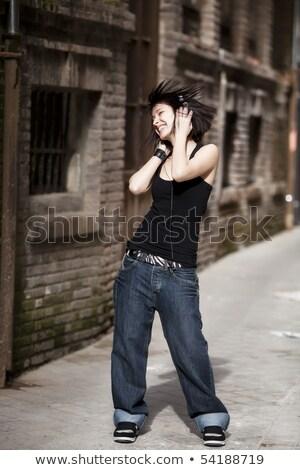 tiener · meisje · genieten · muziek · geïsoleerd · witte - stockfoto © stockyimages