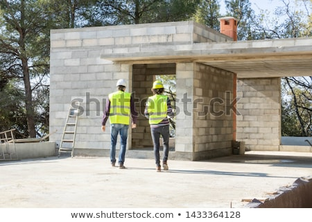 Bricklayer and apprentice with a block wall Stock photo © photography33