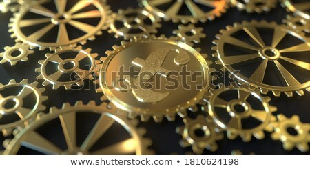 pound golden symbol and metal cogs stock photo © donskarpo