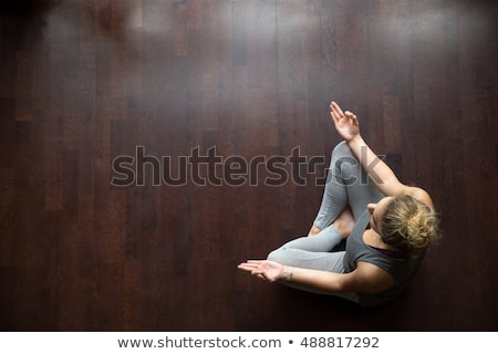 beautiful female legs on wooden floor stock photo © ziprashantzi