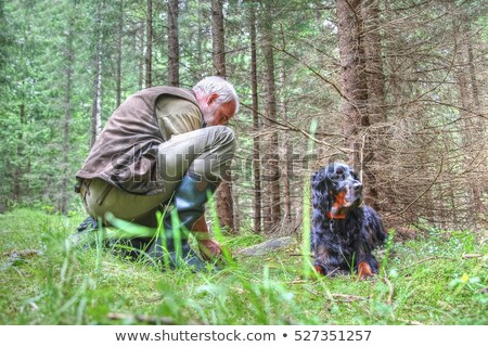 Hunter kneeling by dog Stock photo © photography33