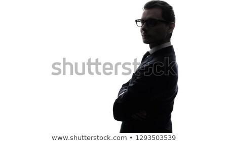 Grave empresario doblado armas mirando cámara Foto stock © wavebreak_media