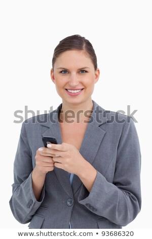 közelkép · mosolyog · tart · mobiltelefon · fehér · mosoly - stock fotó © wavebreak_media