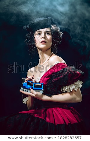güzel · genç · kadın · kırmızı · elbise · yüz · model - stok fotoğraf © pandorabox