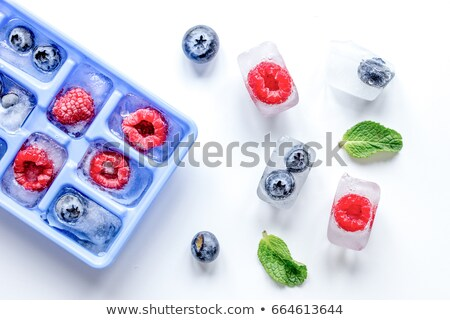 raspberry in ice cube Stock photo © Tomjac1980