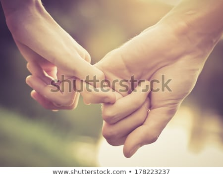 a pair of holding hands colorful people stock photo © kirill_m