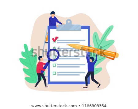 Smiling businessman filling out job application on clipboard fro stock photo © dgilder