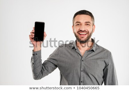 businessman posing to camera over white stock photo © stockyimages