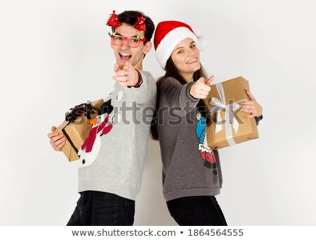 Smiling young santa pointing at you Stock photo © feedough