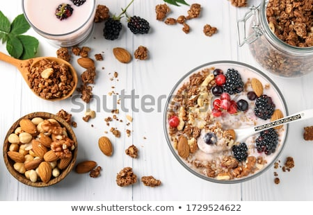 healthy breakfast oatmeal with dried  fruit and nut toppings Stock photo © martince2