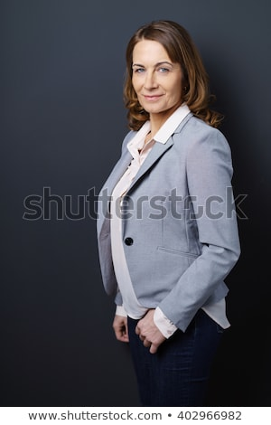 Business woman posing sideways Stock photo © stockyimages