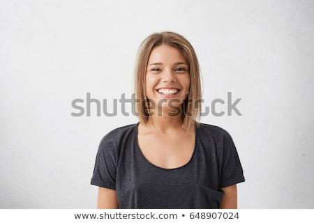 Portrait of the smiling girl over dark background Stock photo © dashapetrenko