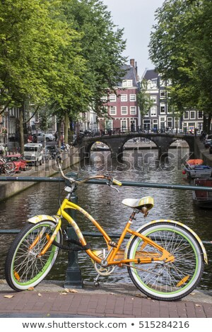 Stock photo: house and canal with green bike