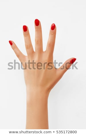 red nail polish in woman hands on white background stock photo © tetkoren
