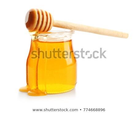 Honing geïsoleerd jar klein honingraat Stockfoto © jordanrusev