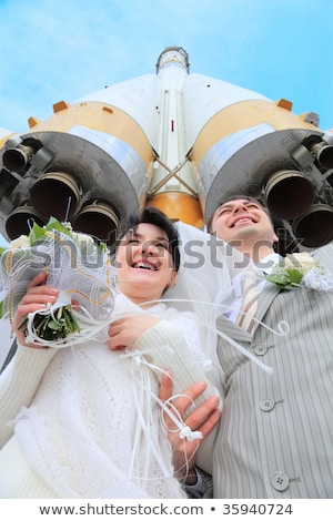Space rocket over fiance and  bride Stock photo © Paha_L