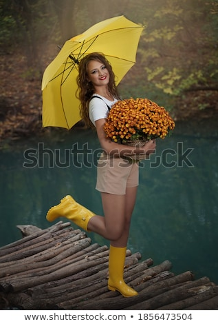 girl with bouquet and umbrella stock photo © svetography