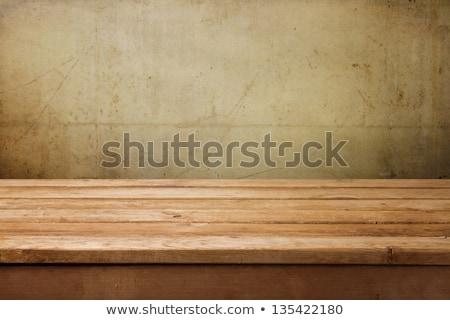 empty wooden table over vintage concrete background stock photo © punsayaporn