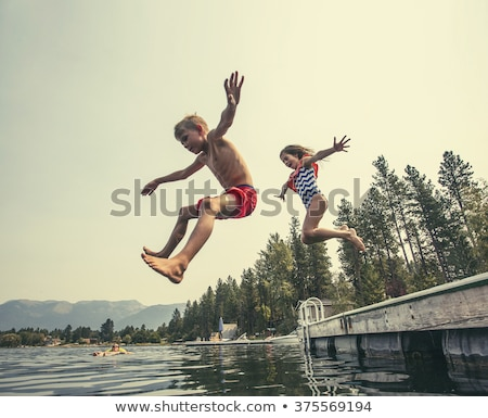 girl on dock by the beautiful lake stock photo © zurijeta