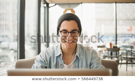 Portriat of a young guy wearing eyeglasses Stock photo © konradbak