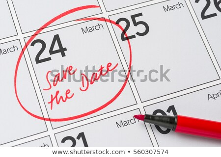 Stock photo: Save the Date written on a calendar - March 24