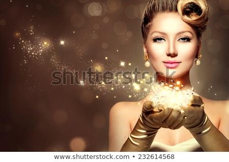 Gyönyörű arany báj nő előkelő visel Stock fotó © zdenkam