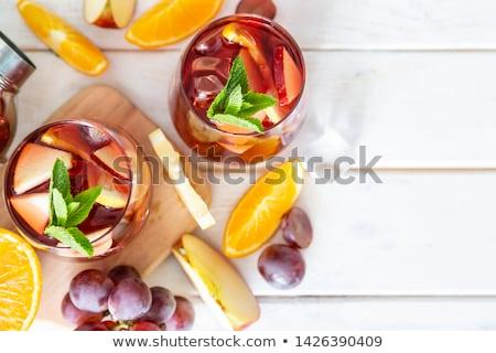 Sangria  and ingredients in glasses  on a rustic wood stock photo © Yatsenko