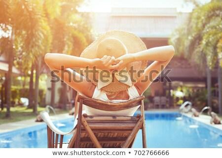 Kadın turist rahatlatıcı güverte sandalye plaj Stok fotoğraf © Kzenon