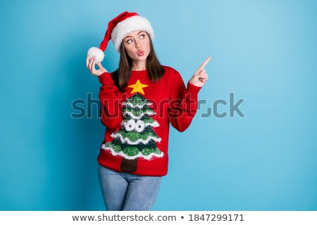 woman playing with the pompom on a santa hat stock photo © dash