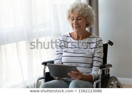 инвалидов человек коляске таблетка Сток-фото © studiostoks