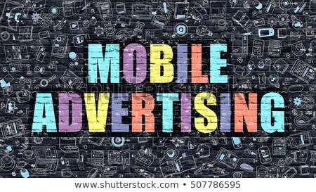 multicolor advertising on dark brickwall doodle style stock photo © tashatuvango