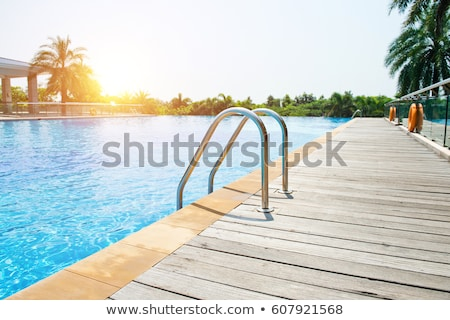 close up of outdoor swimming pool blue water stock photo © dolgachov
