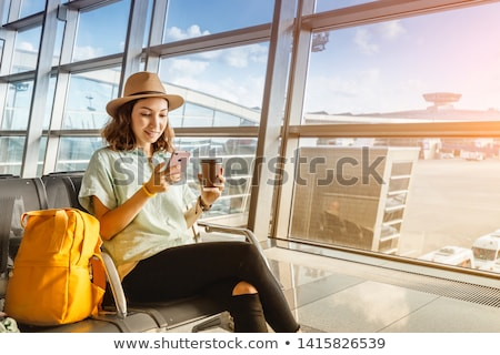 Woman at Airport phoning Stock photo © IS2