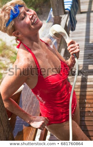 Mujer madura traje de baño mujer deporte rojo Foto stock © IS2
