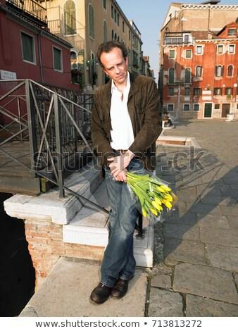 Férfi vár köteg tulipánok Velence farmer Stock fotó © IS2
