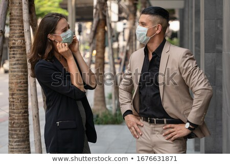 Businesspeople Walking Outside Office Building Stock photo © AndreyPopov