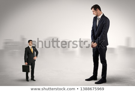 Foto stock: Giant Businessman Is Afraid Of Small Executor