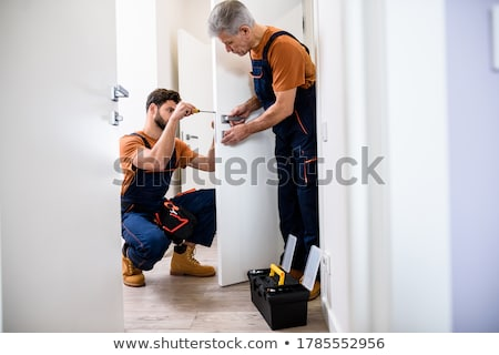 Male Technician Holding Toolbox Stock photo © AndreyPopov
