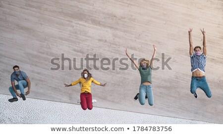 Feliz estudiantes amigos saltar aire libre Foto stock © dolgachov