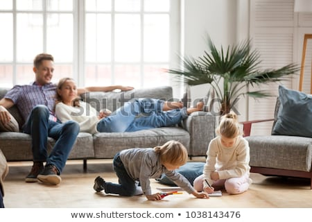 father and son having fun at home in living room stock photo © lopolo