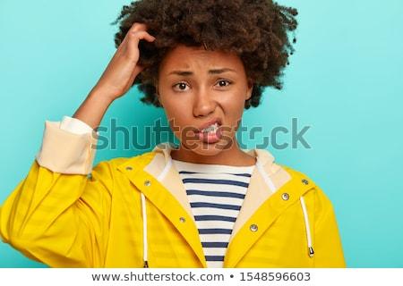 混乱 若い女の子 着用 レインコート 立って 孤立した ストックフォト © deandrobot