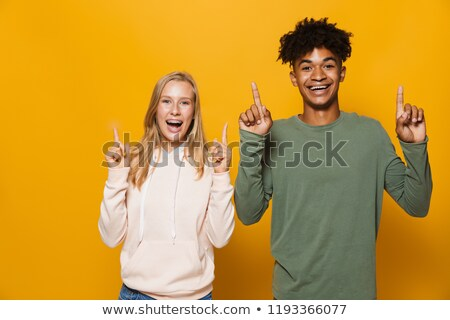 photo of multiethnic friends man and woman 16 18 with dental bra stock photo © deandrobot