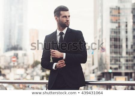 Jólöltözött férfi másfelé néz kéz kabát sötétszürke Stock fotó © feedough