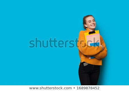 Lovely red haired teenage girl in earphones Stock photo © deandrobot