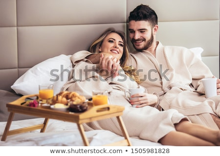 Young happy couple in hotel room in the morning. Stock photo © ruslanshramko