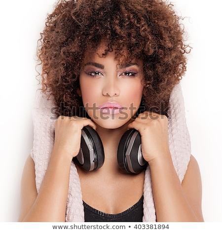 gyönyörű · fiatal · nő · zenét · hallgat · fejhallgató · színpad · fények - stock fotó © lithian