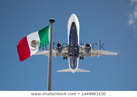 Bottom View of Passenger Airplane Flying Over Waving Mexico Flag Stock photo © feverpitch