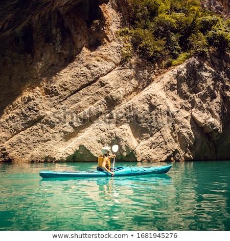 Woman on a kayak in the Pyrenees mountains in Catalonia Stock photo © Kzenon